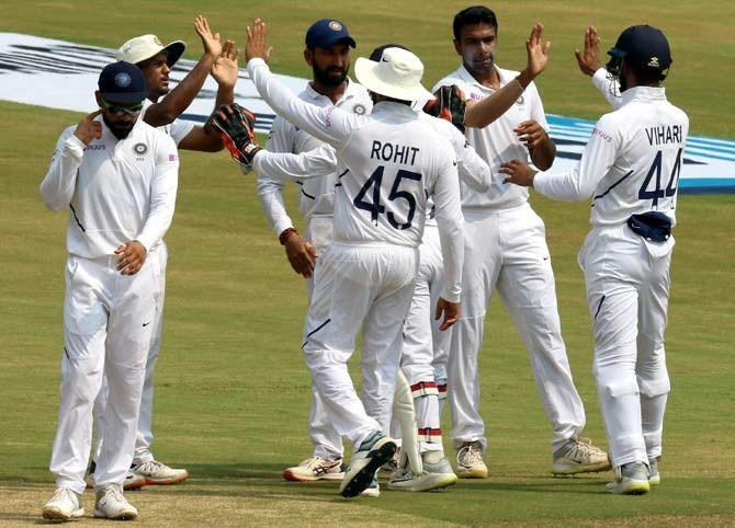 India's players celebrate after Ravichandran Ashwin dismissed Keshav Maharaj