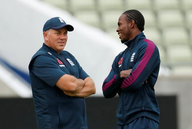 England's pacer Jofra Archer chalts bowling coach Chris Silverwood during nets.