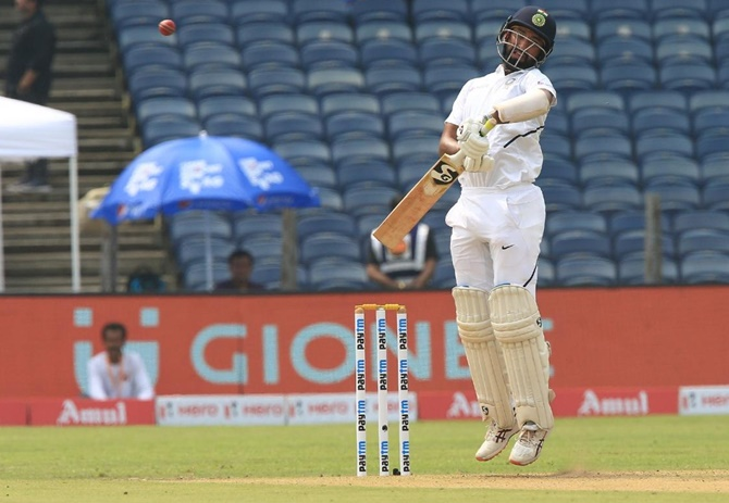 Cheteshwar Pujara checks his shot to avoid a bouncer from Anrich Nortje