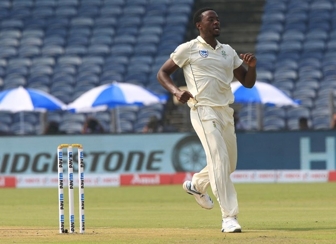 South Africa pacer Kagiso Rabada celebrates after dismissing India opener Rohit Sharma.
