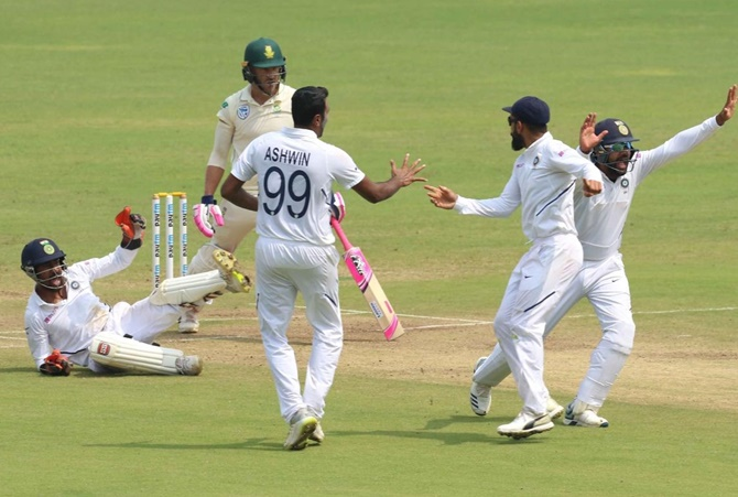 Ravichandran Ashwn celebrates with teammates after Wriddhiman Saha catches Faf du Plessis