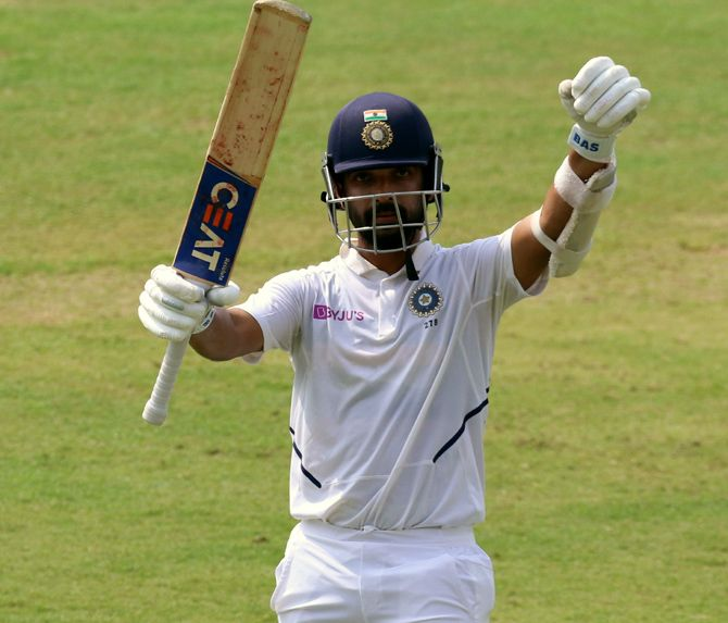 Ajinkya Rahane celebrates completing his century