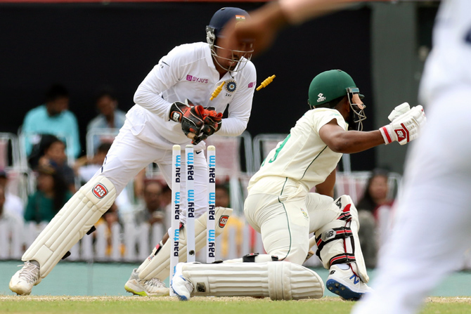 Wriddhiman Saha stumps Temba Bavuma to give debutant Shahbaz Nadeem his first wicket in international cricket.