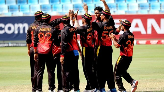 Papua New Guinea players celebrate defeating Kenya in the World T20 qualifier in Dubai on Sunday.