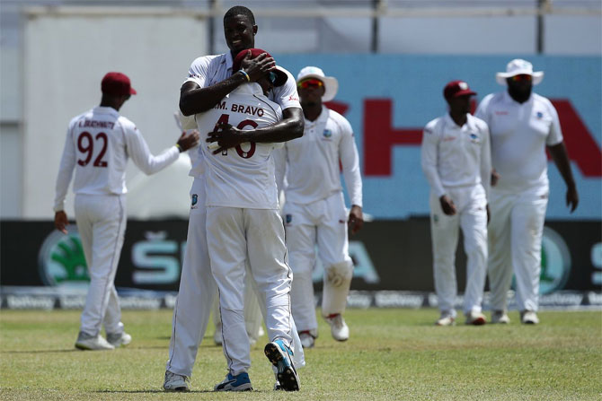 West Indies captain Jason Holder celebrates after taking the wicket of Cheteshwar Pujara