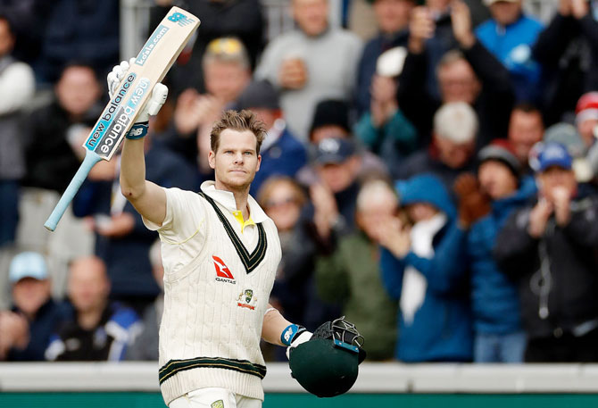 Australia's Steve Smith raises his bat as he leaves the ground after being dismissed for 211 runs on Day 2 of the 4th Ashes Test at Old Trafford in Manchester on Thursday