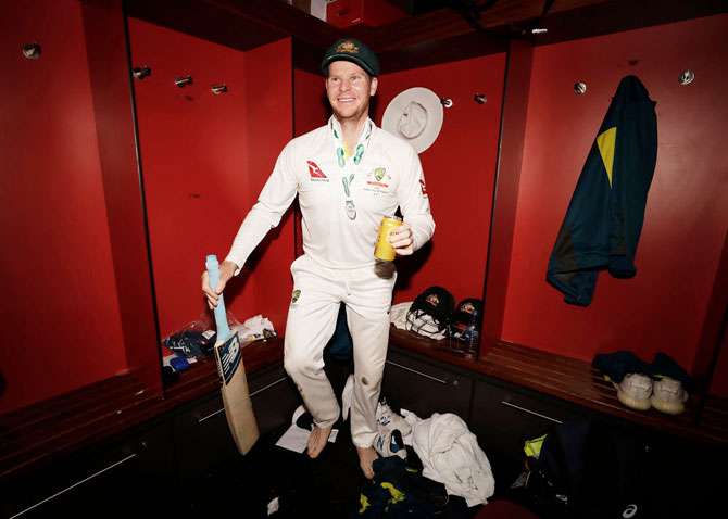 Steve Smith celebrates in the change rooms after Australia claimed victory in the 4th Test to retain the Ashes at Old Trafford in Manchester on Sunday