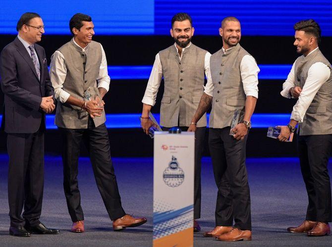 (From left), DDCA president Rajat Sharma, cricketers Navdeep Saini, Virat Kohli,Shikhar Dhawan and Rishabh Pant during a function to rename Feroz Shah Kotla stadium to Arun Jaitley Stadium