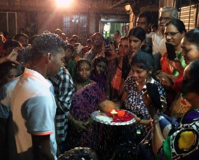 Atharva Ankolekar gets a warm welcome from his friends and neighbours on his arrival in Mumbai on Sunday night.