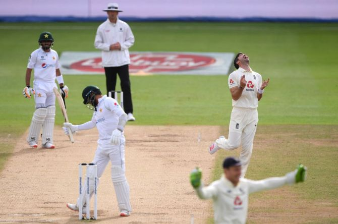 : James Anderson celebrates after taking the wicket of Azhar Ali to reach 600 Test wickets