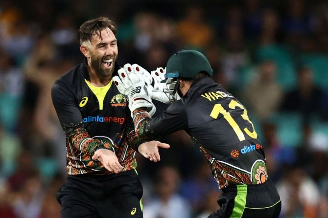 Glenn Maxwell celebrates with Matthew Wade after dismissing KL Rahul