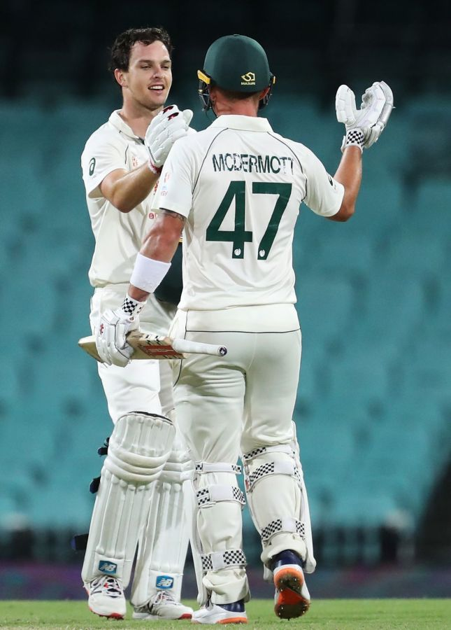Australia A's Jack Wildermuth is congratulated by Ben McDermott on scoring his century