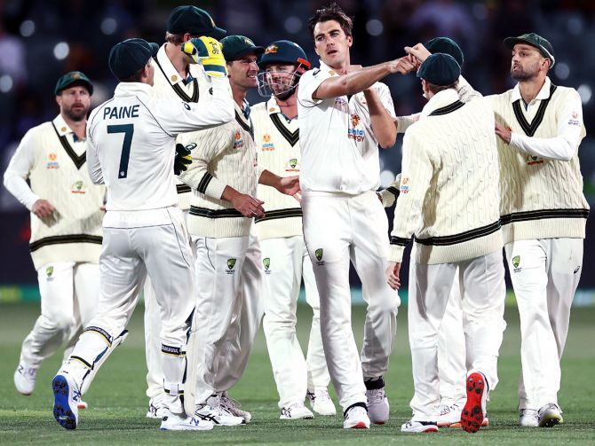 Australia's players celebrate the wicket of opener Prithvi Shaw in India's second innings, on Day 2