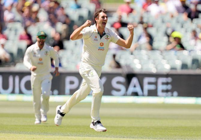 Australia pacer Pat Cummins celebrates after dismissing India captain Virat Kohli in the second innings on Day 3 of the first Test, at the Adelaide Oval