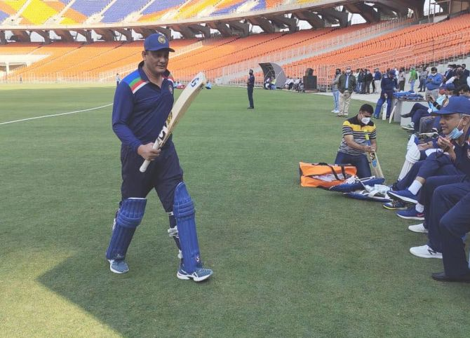 Azharuddin walks back after scoring a quickfire 37 off 22 deliveries for Secretary XI