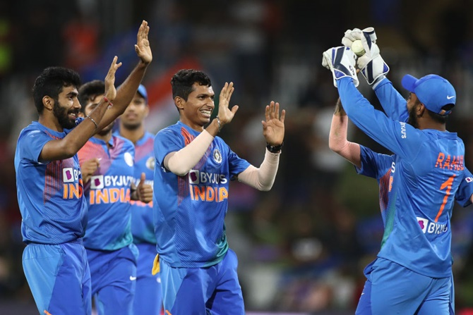 India's Navdeep Saini, centre, celebrates after taking the wicket of New Zealand's Ross Taylor during Game 5 of the Twenty20 series, at Bay Oval, in Mount Maunganui, on Sunday.