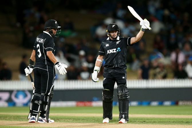 New Zealand's Tom Latham celebrates his half century as Ross Taylor looks on during the first ODI against India, at Seddon Park, in Hamilton, on Wednesday.