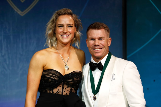Ellyse Perry (left), winner of the Belinda Clark Award, and David Warner, winner of the Allan Border Medal, show off their medals  during the 2020 Cricket Australia Awards