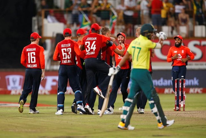 England players celebrate beating South Africa in the second T20I, at the Kingsmead Cricket Ground, in Durban.