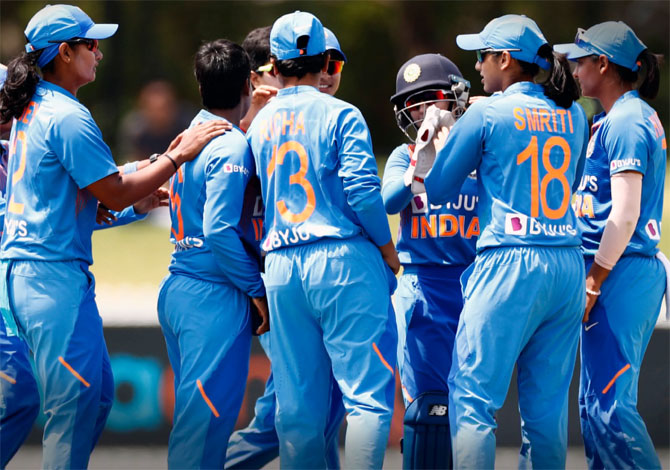 India's players celebrate the fall of a West Indies wicket