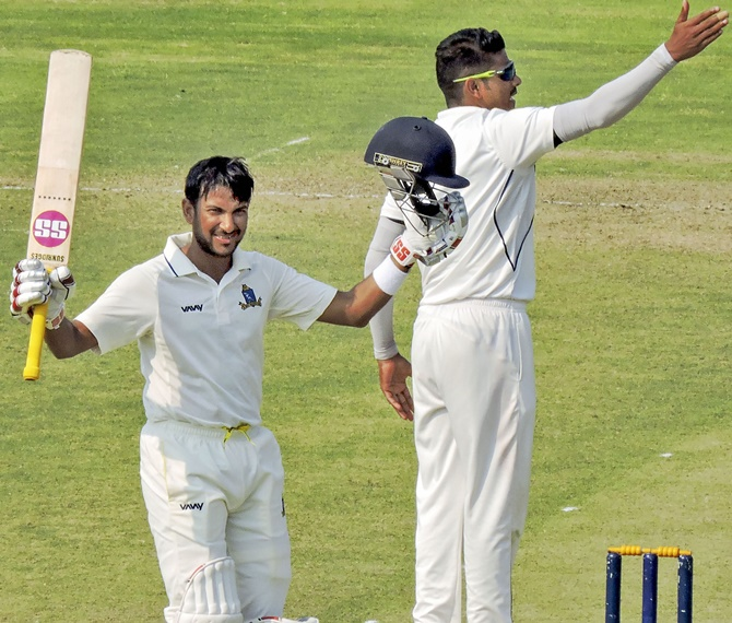 Bengal batsman Anustup Majumdar celebrates after completing his hundred on Day 1 of the Ranji Trophy quarter-final against Odisha, in Cuttack.