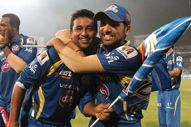 Pragyan Ohja gets a hug from captain Rohit Sharma after Mumbai Indians beat Chennai Super Kings in the final of IPL 2013.