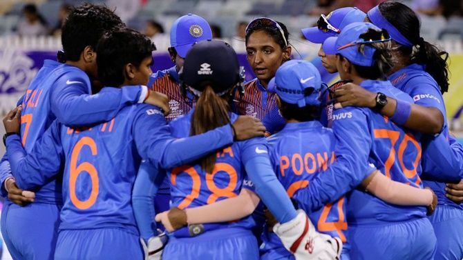 India's captain Harmanpreet Kaur discusses strategy with her teammates before the ICC women's T20 World Cup match against Bangladesh, at the WACA in Perth.