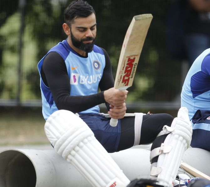 Virat Kohli checks out his bats during Friday's training in Christchurch.