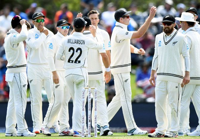 New Zealand's players celebrate after Trent Boult dismisses India opener Mayank Agarwal