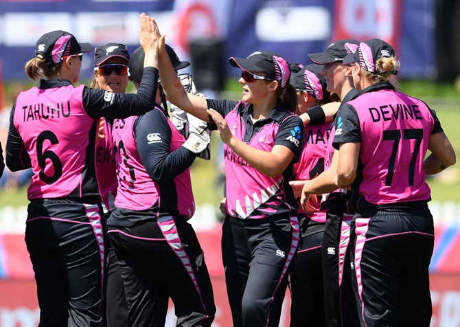 New Zealand's players celebrate after defeating Bangladesh in the women's T20 World Cup, at Junction Oval in Melbourne
