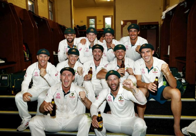 Australia players celebrate in the change rooms after defeating New Zealand on Day 4 of the third Test and sweeping the series 3-0 at Sydney Cricket Ground in Sydney, Australia, on Monday