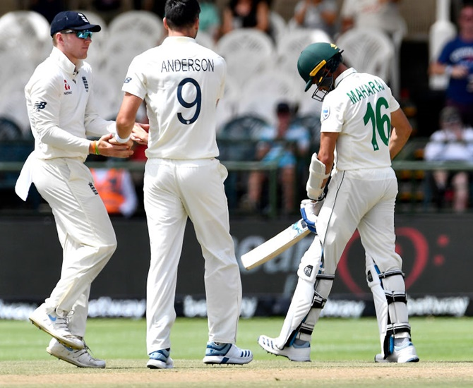 England's James Anderson celebrates after dismissing South Africa's Keshav Maharaj on Tuesday