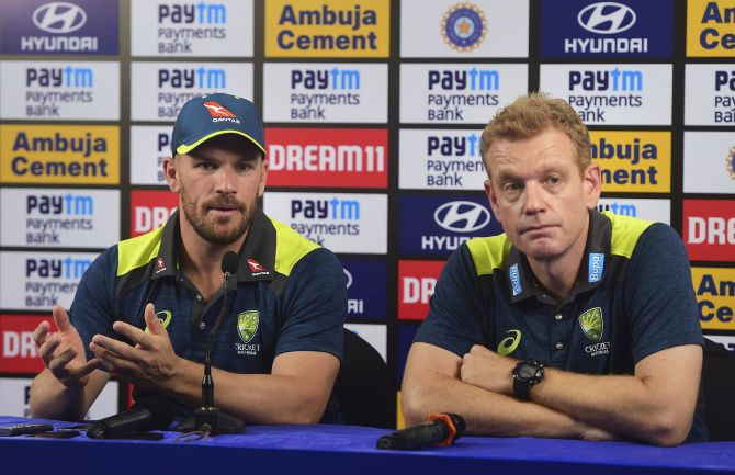 Australian cricket coach Andrew McDonald along with captain Aaron Finch during a press conference in Mumbai on Friday