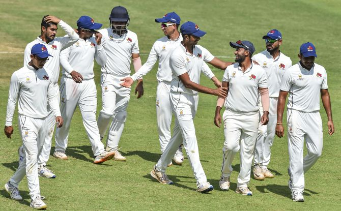 Mumbai left-arm spinner Shams Mulani, centre, who claimed 4 for 72 and scored 87, is congratulated by teammates at the end of the Ranji Trophy match against Tamil Nadu at the MAC stadium, in Chennai, on Tuesday