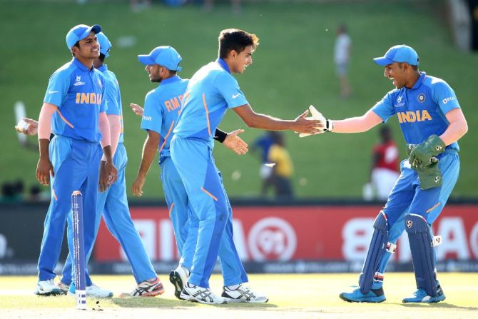 India Under-19 players celebrate a Sri Lankan wicket during their match on Sunday