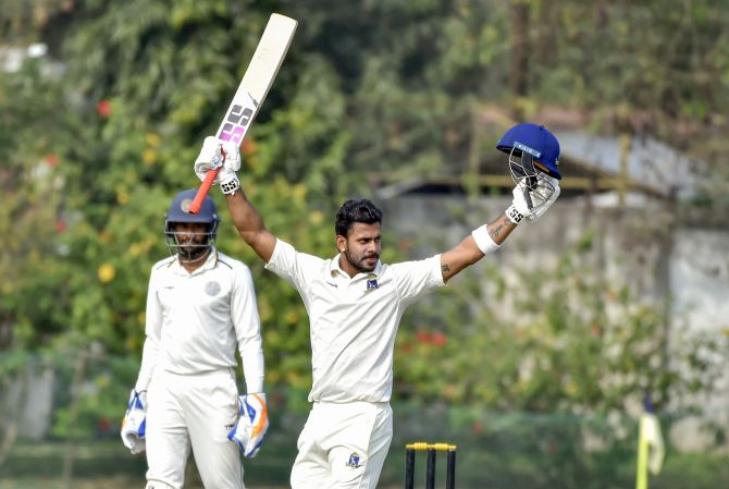 Bengal's Manoj Tiwary celebrates after scoring 300 against Hyderabad on Day 2 day of their Ranji Trophy match, at Kalyani, West Bengal on Monday