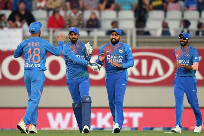 India players celebrate a New Zealand wicket in the first T20I on Friday