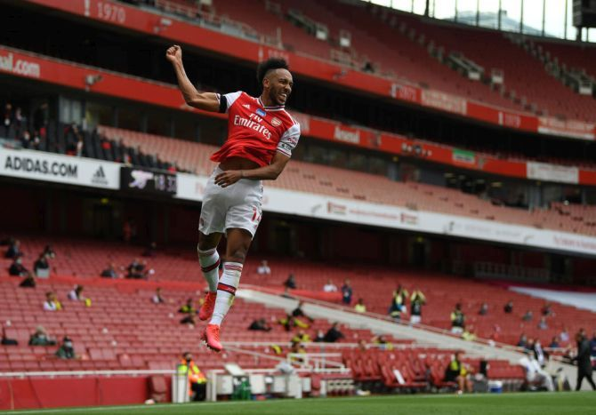 Arsenal's Pierre-Emerick Aubameyang celebrates after scoring against Norwich City during their Premier League match at Emirates Stadium in London.