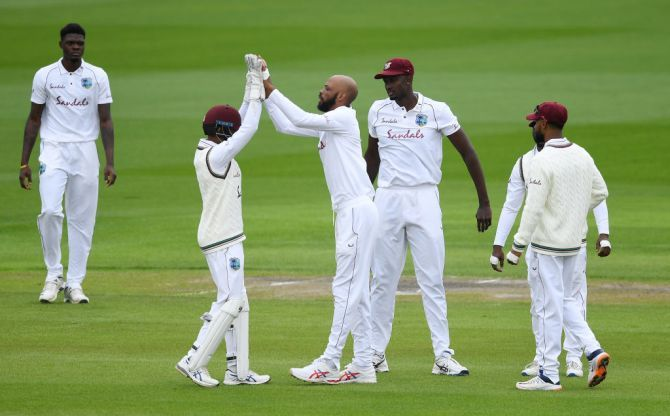 West Indies' Roston Chase celebrates after dismissing England's Rory Burns