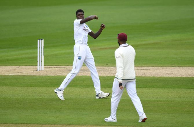 West Indies' Alzarri Joseph celebrates on scalping the wicket of England captain Joe Root
