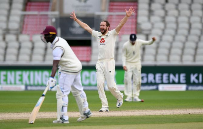 Chris Woakes appeals successfully for the wicket of Roston Chase