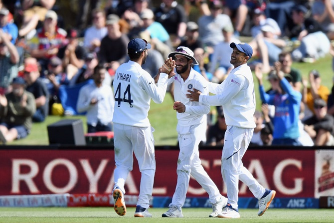 Ravindra Jadeja is congratulated by teammates after taking the catch to dismiss Neil Wagner on Day 2 second Test, at Hagley Oval in Christchurch, on Sunday.
