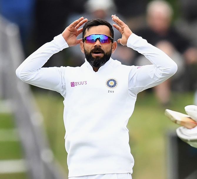 India's skipper Virat Kohli and his teammates celebrate Kane Williamson's dismissal on Day 2 of the second Test against New Zealand, at Hagley Oval in Christchurch, on Sunday.