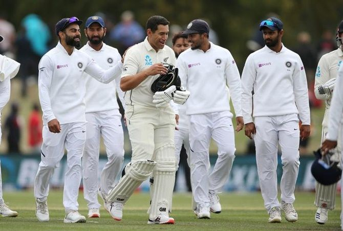 Captain Virat Kohli and his India teammates congratulate New Zealand's Ross Taylor as they leave the field at the end of the second Test, on Day 3, at Hagley Oval in Christchurch, on Monday.