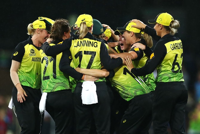 Australia's players celebrate victory over South Africa in the ICC women's T20 World Cup semi-final at the Sydney Cricket Ground on Thursday.
