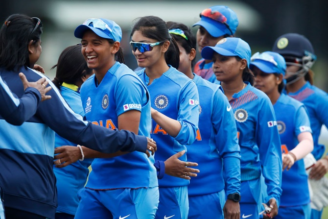 The Indian team exchanges pleasantaries with New Zealand's players after their ICC women's T20 World Cup match at Junction Oval,  in Melbourne.