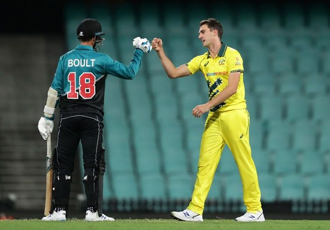 Australia's Pat Cummins taps fists with New Zealand's Trent Boult at the end of the first One Day International at the Sydney Cricket Ground, in Sydney, on Friday.