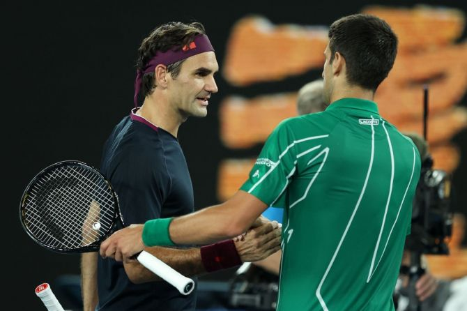 Serbia's Novak Djokovic shakes hands with Switzerland's Roger Federer after their men's singles semi-final at the 2020 Australian Open