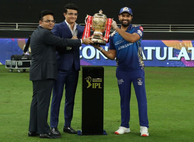 BCCI Secretary Jay Shah and BCCI President Sourav Ganguly present the winners' trophy to MI captain Rohit Sharma after winning the IPL final on Tuesday