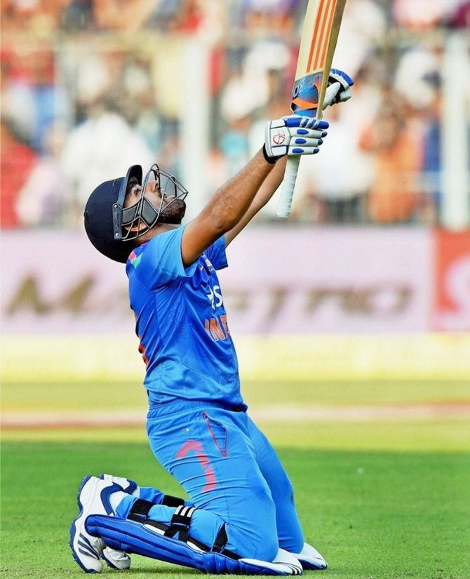 Rohit Sharma celebrates on scoring a double century en route his innings of 264 against Sri Lanka at Eden Gardens on November 13, 2014